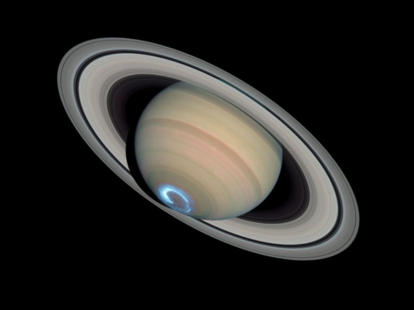 An aurora on the south pole of Saturn caused in part by Saturn's magnetosphere. Credit: NASA, ESA, J. Clarke (Boston University), and Z. Levay